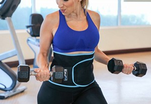 A beautiful woman wearing a waist trimmer during exercise