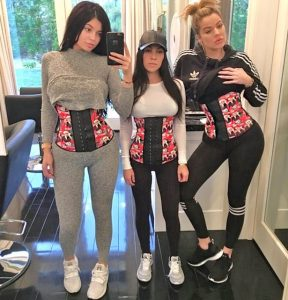 Kourtney Kardashian and her friends with corsets are taking photoes.