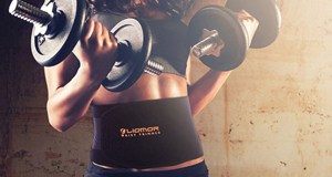 A woman wearing a waist trainer while exercising