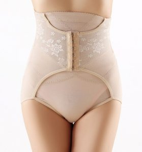 Model with a compression girdle on white background.