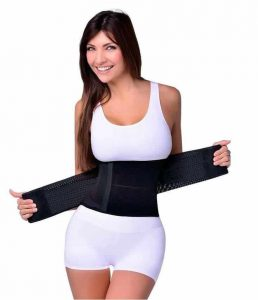 Smiling woman holds waist training.