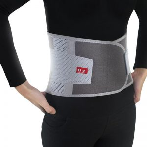 Model with Mcdavid waist trimmer belt on white background.