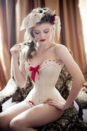 A model wearing a white underbust corset