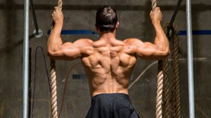 A strong man doing the back exercise