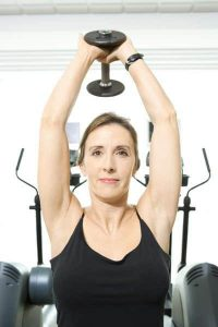 Woman is doing dumbbell pullovers.