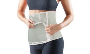Woman is wearing waist trimmer belt.
