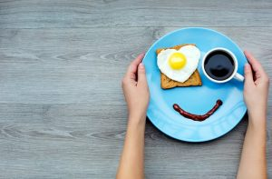 Smile for sweet breakfast in blue plate