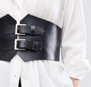 Black corset belt over a white shirt