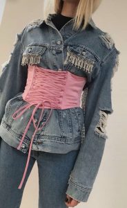 Corset belt over a denim