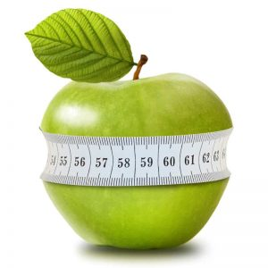 Green apple with measurement on white