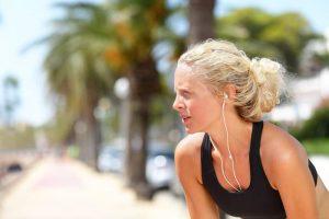 Tired running woman taking a break during run