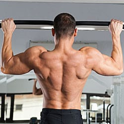 Man doing pull up to work out his lats