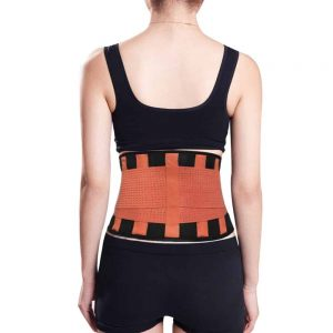 Woman wearing orange medical corset