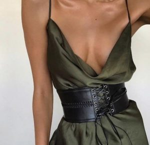 Corset belt over a sexy dress