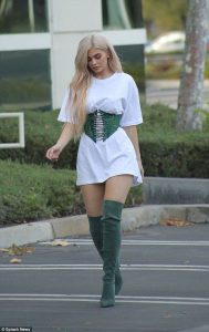 Kylie Jenner wearing an corset belt oversized T-shirt
