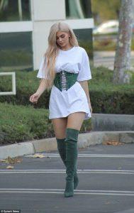 Kylie Jenner wearing an corset belt oversized T-shirt