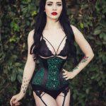 Woman wearing green petite corset