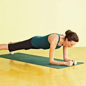 Woman showing plank exercise