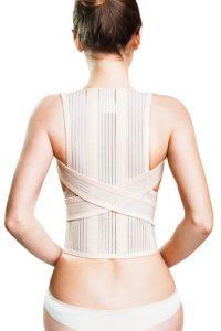 Woman wearing a posture correctors