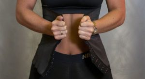 Woman putting on her waist trainer
