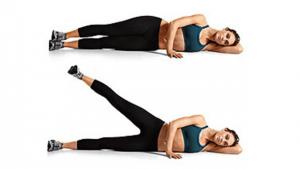 Side leg raises exercise on white background