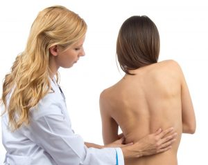 Doctor research patient spine deformity backache