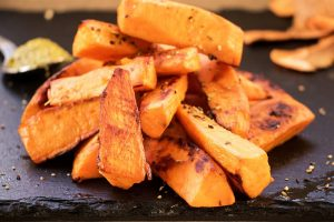 Sweet potato pieces on slate plate