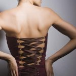 Beautiful woman wearing dark brown waist training corset