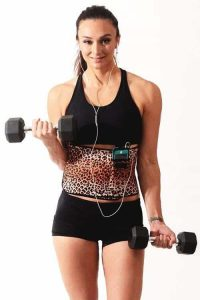 Woman wearing waist trimmer belt and doing exercise
