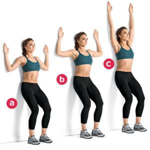 Woman showing wall slide exercise